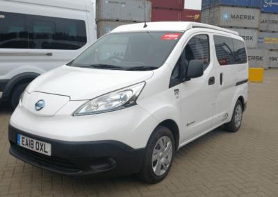 Nissan Quest white minivan
